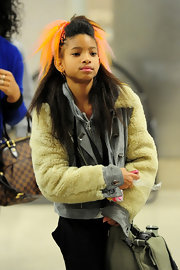 Willow Smith showed off yet another hairstyle while making her way through LAX. Orange and pink highlights completed her voluminous half up hairstyle.