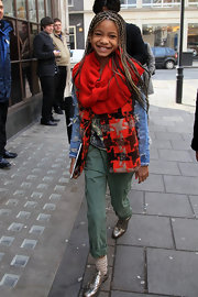 Willow bundles up at BBC Radio in a vivid red scarf.