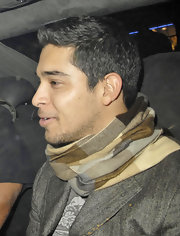 Wilmer Valderrama added a patterned scarf to his outfit while out at Movida nightclub in London.