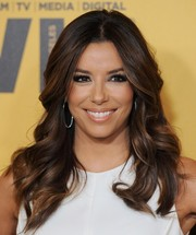 Eva Longoria looked downright fab with her flawless waves at the Crystal + Lucy Awards.