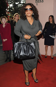 Oprah Winfrey attended the Women in Entertainment Breakfast carrying a stylish black leather tote.