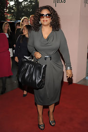 Oprah Winfrey looked fab in her figure-flattering gray cowl-neck dress at the Women in Entertainment Breakfast.