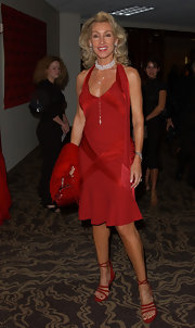 Linda went for a sultry look by pairing red strappy sandals with her red-hot halter dress.