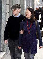 Soon-Yi Previn layered a blue cable-knit vest over a turtleneck for a retro feel while taking a stroll with husband Woody Allen.
