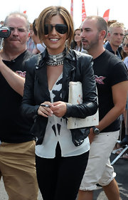 Cheryl arrived in style, hopping off of a helicopter  in a chic leather jacket with dark aviator sunglasses.