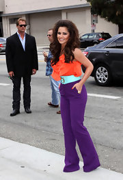 Cheryl combines colors in a pair of purple stretch pants and orange tank.