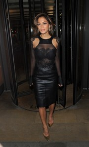 Nicole Scherzinger looked downright fab in a sheer black lace blouse with shoulder cutouts during a dinner out in London.