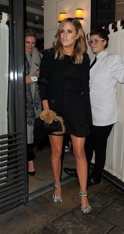Caroline Flack looked low-key in a black blazer layered over an LBD during a night out in London.