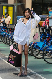 The slender model lugged a black Victoria's Secret shopper bag printed with the words, 'Love Xiao.'