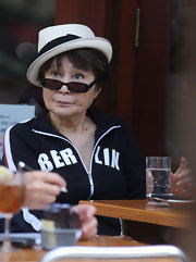 Yoko Ono wore a dainty white fedora with a black bow at lunch in Da Silvano.