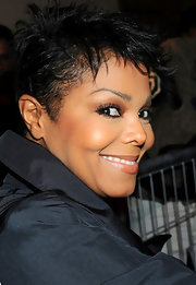 Janet showed off her newly shortened pixie cut while attending the YSL Spring 2011 fashion show.