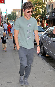 Zac Efron kept it casual in a heather green graphic tee.