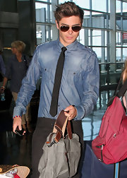 Zac Efron donned a chambray button down with a retro-inspired skinny tie.