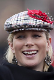 Zara Phillips looked fashionable in an embellished newsboy cap at the Cheltenham Festival.