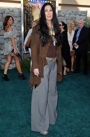 Cher kept it casual in a soft brown suede jacket and gray slacks at the 'Zookeeper' world premiere.