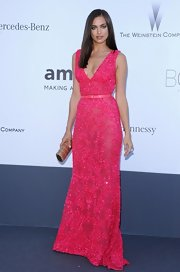 Irina Shayk chose a bright pink sleeveless  deep V-neck gown for the amFAR Cinema Against AIDS.