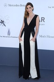 Clotilde Courau rocked a long black dress with cutout panels over a pair of white slacks at the amFAR Cinema Against AIDS Gala.