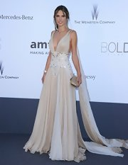 Alessandra Ambrosio looked like a Grecian goddess in a nude chiffon dress with a beaded waist.