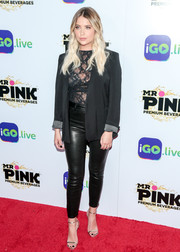 Ashley Benson completed her black look with a pair of leather skinnies.