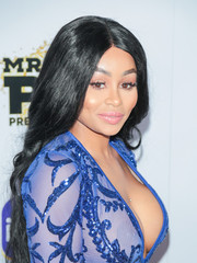 Blac Chyna wore her long hair down with a center part and just a slight wave at the iGo.live launch event.