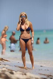 Jill Martin hit the beach sporting a slinky string bikini.