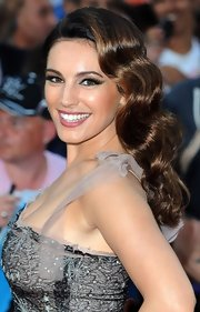 Kelly Brook's shiny locks looked too pretty to be true at the 'Keith Lemon' premiere.