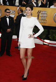 Jennifer Carpenter looked stunning in a pristine white long sleeved mini dress with futuristic puff sleeves.