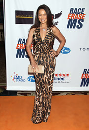 Tia Carrere sizzled in a curve-hugging leopard-print halter dress at the Race to Erase MS event.