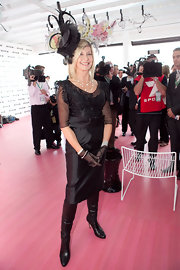 Olivia Newton-John finished her 2009 Melbourne Cup outfit with a pair of knee-high boots.