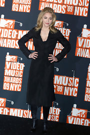 Madonna donned an elegant black evening coat for the 2009 MTV MVAs.
