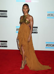 Jada Pinkett Smith was a bronze goddess in Christian Louboutin Tinazata peep-toes. The strappy metallic heels perfectly complemented her Emilio Pucci gown.