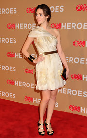 Emmy Rossum looked stunning in Pierre Hardy heels. She paired the gold-trimmed heels with a one shoulder ladylike frock.