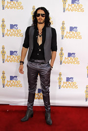 No one can pull off this look like Russell Brand. The British comedian wore a classic gray vest over an unbuttoned black shirt with satin trousers.