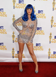 Katy Perry paired her gemstone encrusted dress with bright yellow nail polish.