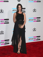 Alanis Morissette topped off her black asymmetrical gown with strappy sandals.