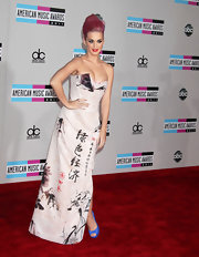 Katy Perry added a pop of color to her Vivienne Westwood frock with electric blue peep-toe pumps.