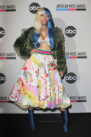 Nicki Minaj opted for an eclectic ensemble at the AMA press conference. She donned a full skirt paired with metallic blue boots.