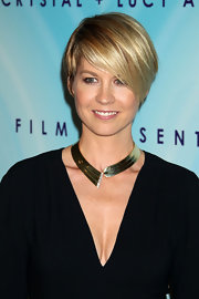 Jenna Elfman wore a bold statement necklace of gold with a diamond band at the 2011 Crystal & Lucy Awards.