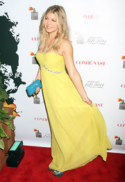 Fergie added a pop of color to her canary yellow gown with a sparkly turquoise hard case clutch.