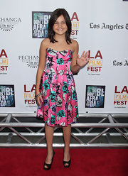 Bailee Madison waved to the press at the 'Don't Be Afraid of the Dark' premiere wearing a floral satin dress.