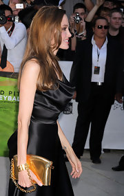 Angelina Jolie was literally attached at the wrist to her little golden clutch at the Toronto premiere of 'Moneyball'.