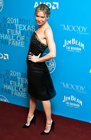 Renee wears a beaded little black strapless dress to the Texas Film Hall of Fame Awards.