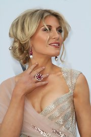 Hofit golan rocked a classic chignon at the amfAR Gala. Loose center part tendrils framed her face.