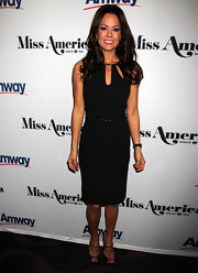 Brooke Burke finished off her chic LBD with metallic peep-toe pumps complete with ankle strap detailing.