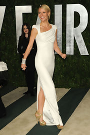 Gwyneth added shine to her winning look with platform sandals.