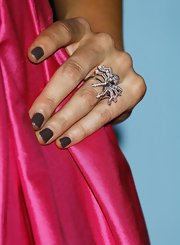 Stacy showed off her creepy spider ring while walking the red carpet. She rocked the on-trend mushroom polish color to top her look off.