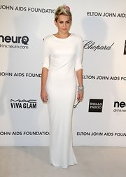 Miley Cyrus kept her look classic and sophisticated at Elton John's Oscar Viewing Party with a white crepe jersey dress with a pearl and crystal embroidered halter.