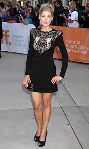 Rosamund Pike paired a unique black mini dress with platform peep-toe pumps.