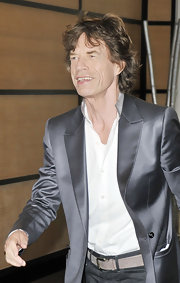 A silk gray blazer smartened up Mick Jagger's jeans and open-collar shirt at a photo call in Cannes.