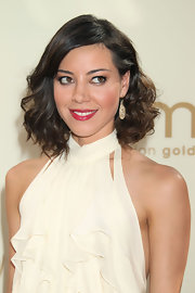 Aubrey Plaza looked very feminine at the 2011 Emmys with gold dangle earrings teamed with a curly 'do and a frilly dress.